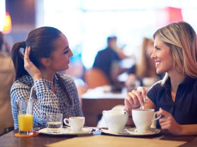 Woman discuss business/coffee